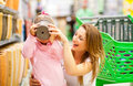 Mother daughter in supermarket Stock Images