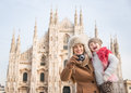 Mother and daughter taking photos in front of duomo milan why not to hang out italian fashion capital on winter holidays with Royalty Free Stock Photos