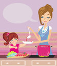 Mother and daughter tests food in the kitchen