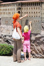 Mother and daughter touch walls of sumela monastry istanbul july near trabzon model in miniaturk museum on july in istanbul turkey Royalty Free Stock Image