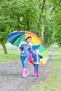 Mother and daughter with umbrellas Stock Photos
