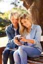 Mother daughter viewing pictures and on camera at the park Stock Image