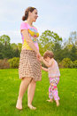Mother with  daughter walk barefoot Stock Photography