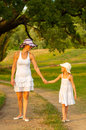 Mother and daughter walking in the nature Stock Images