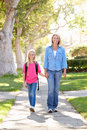 Mother And Daughter Walking To School On Suburban Street Royalty Free Stock Photos
