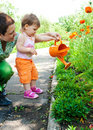 Mother and daughter watering plants Royalty Free Stock Image