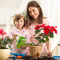 Mother and daughter watering plants together Royalty Free Stock Photos