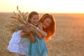 Mother with daughter at the wheat field Royalty Free Stock Photo