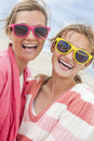 Mother daughter woman girl sunglasses on beach women female child having fun wearing taking selfie photograph a Stock Images
