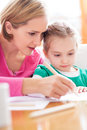 Mother and daughter writing together Stock Photo