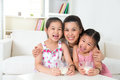 Mother and daughters drinking milk happy asian at home parent children beautiful family model Stock Image