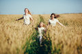 Mother and daugthers run on wheat filed Royalty Free Stock Photo