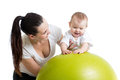 Mother doing gymnastics with baby on fit ball fitness Royalty Free Stock Image