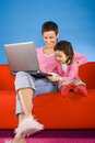 Mother and douther with laptop Stock Images