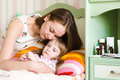 Mother embraces the sick child Royalty Free Stock Photo