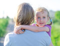 Mother embracing her daughter outdoors Royalty Free Stock Photography