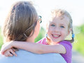 Mother embracing her daughter outdoors Royalty Free Stock Photos