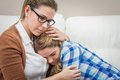 Mother embracing and soothes depressed daughter teen by problems Royalty Free Stock Images