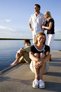 Mother and family, sunny day on dock by water Royalty Free Stock Images