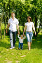 Mother, father and baby walking Royalty Free Stock Photo