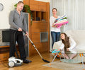 Mother, father and girl doing general cleaning Royalty Free Stock Photo