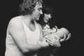 Mother and father holding their newborn son baby in arms Stock Photos