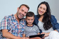 Mother, father and son using digital tablet Royalty Free Stock Photo