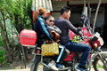 Mother father young son wearing sporty sunglasses family motorcycle riding along country road pengzhou china Royalty Free Stock Images