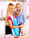 Mother  feed child at kitchen. Royalty Free Stock Photos