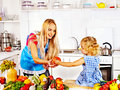 Mother feed child at kitchen happy Royalty Free Stock Photo