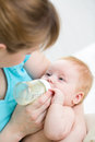 Mother feeding baby from bottle boy Royalty Free Stock Image