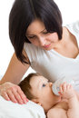 Mother feeding baby from bottle boy Royalty Free Stock Photos