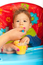 Mother feeding baby boy with vegetables puree Stock Images