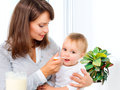 Mother feeding her baby girl with a spoon Royalty Free Stock Images