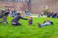 Mother feeding her baby girl with a spoon milan italy march in the park on march Stock Image