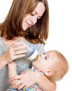 Mother feeding her cute baby boy from bottle Royalty Free Stock Image