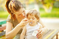 Mother feeding her son Royalty Free Stock Photo