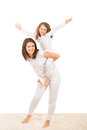 Mother and girl having fun home daughter offering to her piggy back ride Royalty Free Stock Image