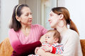 Mother gives solace to crying adult daughter Royalty Free Stock Photo