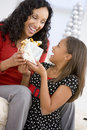 Mother Giving Daughter Her Christmas Present Stock Images
