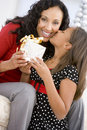 Mother Giving Daughter Her Christmas Present Royalty Free Stock Photo