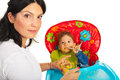 Mother giving food to messy baby her boy against white background Royalty Free Stock Photos
