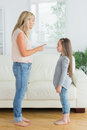 Mother giving out to daughter in the living room Royalty Free Stock Photo