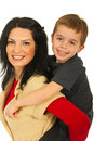 Mother giving piggy back ride to son Royalty Free Stock Photo