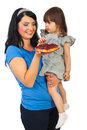Mother giving tart fruit to daughter Royalty Free Stock Photo