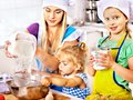 Mother and grandchild baking cookies granddaughter Royalty Free Stock Image
