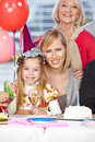 Mother and grandmother celebrating happy their daughter s birthday Stock Photo