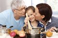 Mother granny and little daughter cooking Royalty Free Stock Photography