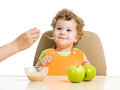 Mother hand spoon feeding baby boy Stock Images
