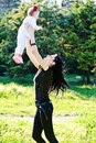 Mother having fun with baby daughter young focus on Royalty Free Stock Images